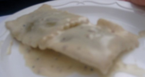 blurry porcini ravioli with champagne truffle cream sauce